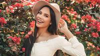 ilustrasi perempuan bahagia/Photo by Renato Abati from Pexels