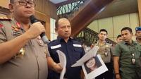 Polisi Tetapkan 1 Tersangka Baru Kasus Insiden Asrama Mahasiswa Papua.(Merdeka.com/Erwin Yohanes)