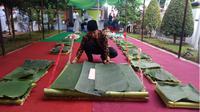 """Tempat nasi tradisional """"Ancak"""" menghiasi Isra Mikraj di Banyuwangi. (Liputan6.com/Dian Kurniawan)"""