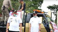 Wakil Wali Kota Bukittinggi, Irwandi (kanan) terindikasi terjangkit virus corona Covid-19 setelah menjalani rapid tes.