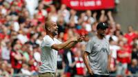 Manajer Manchester City, Pep Guardiola, mengaku puas dengan pertandingan kontra Liverpool pada laga Community Shield 2019, di Stadion Wembley, Minggu (4/8/2019). (AFP/Ian Kington)