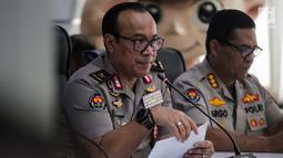 Kabiropenmas Divisi Humas Polri Dedi Prasetyo memberikan keterangan hasil investigasi kerusuhan 21-22 Mei 2019 di Jakarta, Jumat (5/7/2019). Polisi mengungkapkan ada delapan kelompok yang merancang kerusuhan 21-22 Mei pada beberapa titik Ibu Kota Jakarta. (Liputan6.com/Faizal Fanani)