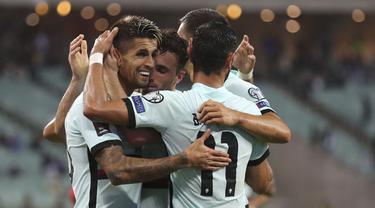Timnas Portugal sukses mencuri poin penuh dari lawatannya ke markas Azerbaijan pada laga keenam grup A kualifikasi Piala Dunia 2022 zona Eropa. (Foto: AP/Aziz Karimov)