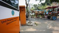 Unit Pengelola Teknis (UPT) Parkir Dinas Perhubungan dan Transportasi DKI Jakarta menyiapkan konsep perombakan sistem parkir di kawasan IRTI Monas, Jakarta, Selasa (26/5/2015). Pengelolaan parkir akan melibatkan pihak swasta. (Liputan6.com/Faizal Fanani)