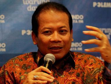 Wakil Ketua DPR RI Taufik Kurniawan berbicara saat diskusi polemik bertajuk 'Banyak Pilihan Untuk Jokowi' di Jakarta, Sabtu (7/2/2015). (Liputan6.com/Johan Tallo)