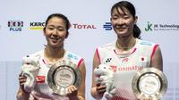 Jepang menjadi juara umum Singapura Terbuka 2019 setelah memborong tiga gelar melalui nomor tunggal putra, ganda putra, dan ganda putri. (AFP/Theodore Lim)
