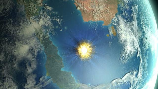 Ilustrasi kawah Chicxulub, bukti asteroid pernah jatuh ke bumi (Mark Garlick/ Science Photo Library/AFP Photo)
