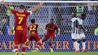 Tammy Abraham saat mencetak gol kemenangan AS Roma atas Udinese di ajang Serie A. (Alberto PIZZOLI / AFP)