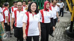 Menteri PMK, Puan Maharani tiba untuk menghadiri acara Deklarasi  Revolusi Mental dilingkungan BPJS Ketenagakerjaan, Jakarta, Rabu (23/3). Perubahan pelayanan yang lebih terukur, pemberian manfaat yang prima dan pasti. (Liputn6.com/Faizal Fanani)