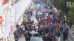 Suasana acara Torch Relay Asian Games 2018 di kawasan TMII, Jakarta Timur, Rabu (15/8).  Sementara pada Kamis (16/8), obor akan mengelilingi wilayah Jakpus, Jakbar dan Jakarta Utara. (Liputan6.com/Immanuel Antonius)