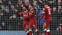 Winger Liverpool, Mohamed Salah merayakan gol ke gawang Watford pada laga pekan ke-31 Premier League 2017-2018 di Stadion Anfield, Minggu (18/3/2018) dini hari WIB. (Anthony Devlin/PA via AP)