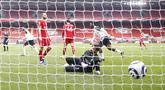 Penjaga gawang Liverpool Alisson gagal menyelamatkan gawangnya dari tendangan pemain Fulham Mario Lemina pada pertandingan Liga Inggris di Stadion Anfield, Liverpool, Inggris, Minggu (7/3/2021). Liverpool takluk 0-1 dari Fulham. (Phil Noble/Pool via AP)