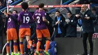 Manajer Manchester City, Pep Guardiola, tak terlalu puas dengan performa anak asuhnya saat menang 3-0 atas Huddersfield Town pada laga pekan ke-23 Premier League, di John Smith's Stadium, Minggu (20/1/2019). (AFP/Paul Ellis)