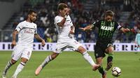 AC Milan menang 3-1 atas Sassuolo pada laga pekan ketujuh Serie A, di Mapei Stadium – Citta del Tricolore, Minggu (30/9/2018). (AFP/Miguel Medina)
