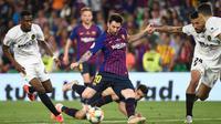 Lionel Messi berhasil mencetak satu gol saat Barcelona bersua Valencia pada final Copa del Rey di Estadio Benito Villamarin, Sabtu (25/5/2019). Meski begitu, Barca tetap kalah 1-2 dari Valencia. (AFPJose Jordan)