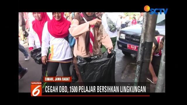 Untuk mencegah DBD, kepolisian Cimahi, Jawa Barat, mengajak 1.500 pelajar bersihkan lingkungan.
