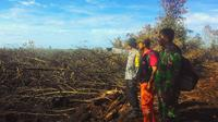 Sudah hampir sepekan Taman Wisata Alam (TWA) Sungai Dumai di Kelurahan Mundam, Kecamatan Medang Kampai, terbakar. (Liputan6.com/M Syukur)