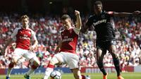 Arsenal menang besar lawan West Ham ( IAN KINGTON / AFP)
