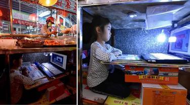 Bocah Ini Rela Belajar di Bawah Meja Tempat Jualan Ibunya, Aksinya Bikin Haru