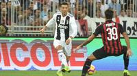 Striker Juventus Cristiano Ronaldo beraksi saat melawan AC Milan pada Piala Super Italia 2018, di Stadion King Abdullah Sports City, Jeddah, Rabu (16/1/2019). (AFP/Fayez Nureldine)