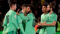 Para pemain Real Madrid merayakan gol ke gawang Unionistas dalam laga 32 besar Copa del Rey, Kamis (23/1/2020). Real Madrid melaju ke babak selanjutnya setelah menang 3-1. (Javier Soriano/AFP)