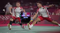 Pasangan Greysia Polii dan Apriyani Rahayu mampu memimpin di awal gim pertama. Permainan yang mereka tunjukkan kepada wakil china berhasil pertahankan keunggulan 11-8 hingga interval gim pertama. (Foto: AP/Dita Alangkara)