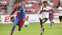 Gerard Pique. Bek tengah Barcelona anggota Akademi La Masia ini memperkuat tim remaja Barcelona mulai 1997-2004. Di musim 2004/2005 ia hijrah ke Manchester United selama 4 musim. Lebih sering menghuni bangku cadangan, ia balik ke Barcelona pada 2008/2009 hingga kini. (Foto: AFP/Thomas Kienzle)