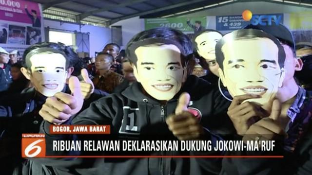 Ribuan Relawan Pos Perjuangan Rakyat untuk Jokowi (Posper) pakai topeng Jokowi di acara deklarasi dukungan.