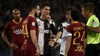 Cristiano Ronaldo saat laga tandang Juventus ke AS Roma di Stadion Olimpico dalam lanjutan Serie A 2018-2019, Senin dini hari WIB (13/5/2019). (AFP/Filippo Monteforte)