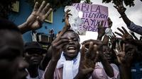 Aksi unjuk rasa di Republik Demokratik Kongo, mendesak Presiden Joseph Kabila turun dari jabatannya (AFP/John Wessels)