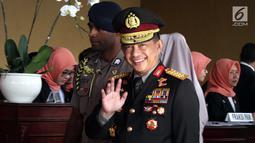 Kapolri Jenderal Pol Tito Karnavian tersenyum saat tiba menghadiri  Sidang Tahunan MPR, DPR dan DPD di Kompleks Parlemen, Senayan, Jakarta, Kamis, (16/8). Tema sidang tahunan kali ini Bhinneka Tunggal Ika. (Liputan6.com/Johan Tallo)