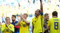 Kapten Swedia, Andreas Granqvist, menyebut kerja keras dan semangat tanpa menyerah jadi kunci mengalahkan Korea Selatan. (AFP/Martin Bernetti)