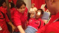 Widodo, pengurus ranting PDIP diduga menjadi korban pengeroyokan oleh ormas usai mengikuti kampanye calon gubernur DKI Jakarta Ahok. (Liputan6.com/Radityo)