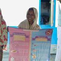 1000 Days Fund mendistribusikan 12.000 poster tinggi badan ke 22 pulau di Indonesia