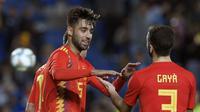 Para pemain Spanyol merayakan gol ke gawang Bosnia-Herzegovina pada laga persahabatan di Stadion de Gran Canaria, Las Palmas, Minggu (18/11/2018). (AFP/Lluis Gene)