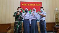 Qyara Maharani Putri (17), siswi kelas XI SMA 1 Garut, Jawa Barat yang satu ini sukses menjadi salah satu anggota Paskibraka Nasional 2021 pada peringatan HUT ke 76 RI di Istana. (Liputan6.com/Jayadi Supriadin)