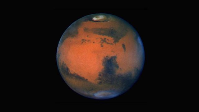 Wajah planet mars terpampang nyata dari lensa teleskop hubble