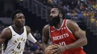 Aksi Bintang Rockets James Harden berduel dengan Victor Oladipo pada lanjutan NBA (AP)