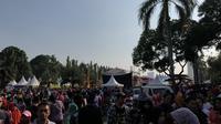 Warga memadati Monas dalam acara Lebaran Betawi di Monas, Minggu (21/7/2019). (Liputan6.com/ Delvira Chaerani Hutabarat)