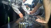 Pascapenembakan perwira Polda Metro Jaya AKBP Pamudji, Polres Bogor periksa senpi anggota.
