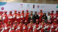 Momen pelepasan kontingen Indonesia yang akan bertanding pada Youth Olympic Games 2018. (doc. Kemenpora).