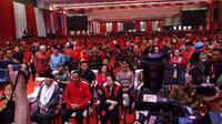Calon Presiden Joko Widodo dan cawapres Ma'ruf Amin duduk di bangku depan bersama Megawati Soekarnoputri dalam perayaan HUT PDIP. (Liputan6.com/Putu Merta Surya Putra)
