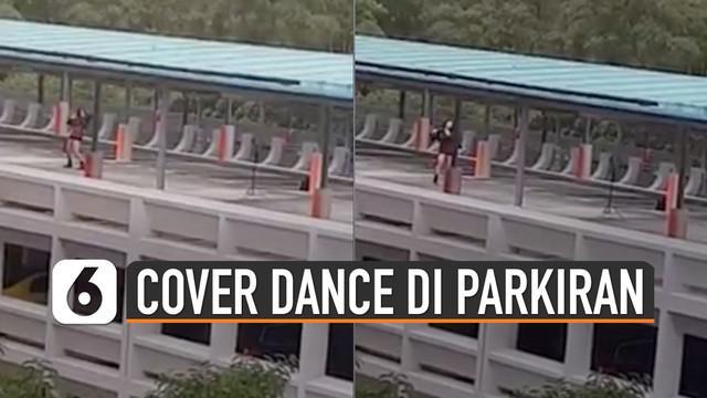Beredar video wanita sedang menari di atas gedung parkiran. Ternyata wanita itu sedang menirukan dance girlband korea Blackpink.