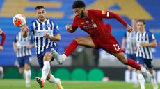 Bek Liverpool, Joe Gomez menendang bola menjauh dari pemain Brighton & Hove Albion, Neal Maupay (kiri) pada lanjutan pertandingan Liga Inggris di Stadion Falmer, Kamis (9/7/2020) dini hari WIB. Liverpool berhasil kalahkan Brighton dengan skor 3-1. (AP Photo/Paul Childs,Pool)