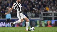 Andrea Barzagli mewanti-wanti Juventus jelang duel melawan AC Milan. (Miguel MEDINA / AFP)