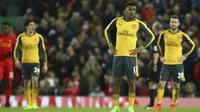 Ekspresi pemain Arsenal, Alex Iwobi usai timnya kalah dari Liverpool pada laga Premier League pekan ke-27 di Anfield, Liverpool, (4/3/2017). Liverpool menang 3-1. (AP/Dave Thompson)