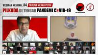 Gubernur Jatim Khofifah Indar Parawansa saat jadi pembicara bersama Ketua Umum Taruna Merah Putih (TMP) Maruarar Sirait dalam webinar Pilkada di Tengah Pandemi Covid-19 yang digelar secara daring, Minggu (9/8/2020) malam. (Ist)