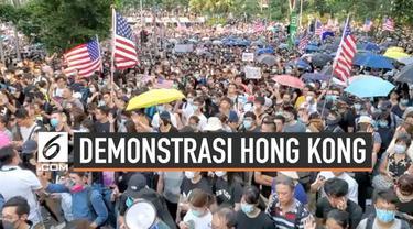 Aksi unjuk rasa masih berlangsung di Hong Kong. Ribuan warga Hong Kong turun ke jalan hari Minggu (8/9/2019), sebagian mereka bawa bendera Amerika Serikat. Untuk apa?