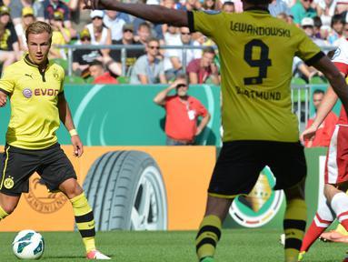 Mario Gotze merupakan pemain yang dibina dari akademi muda Dortmund. Pahlawan Jerman di Piala Dunia 2014 ini, diboyong Munchen pada Juli 2013 dengan mahar sebesar 37 juta euro. (Foto: AFP/Carmen Jaspersen)