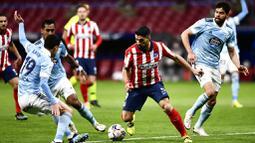 Luis Suarez yang memborong dua gol pada laga itu harus puas timnya hanya bermain imbang 2-2 atas tamunya Celta Vigo di Stadion Wanda Metropolitano. (AP Photo/Jose Breton)
